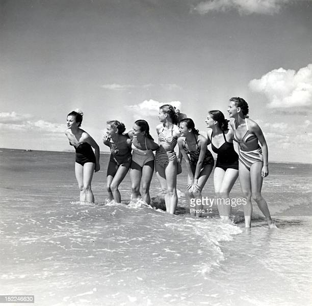 Marquis de Cuevas' company on the beach at Deauville 7 girls 7 nationalities L to r Hungary England France United States Russia Holland Finland...
