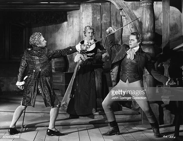 Marquis Don Luis in a sword fight with Denis Moore as Maria Bonnyfeather watches in the 1936 film Anthony Adverse