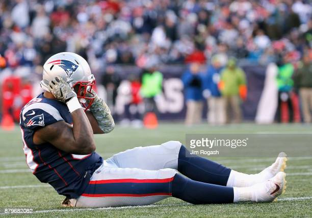 Marquis Flowers of the New England Patriots is injured during the fourth quarter of a game against the Miami Dolphins at Gillette Stadium on November...