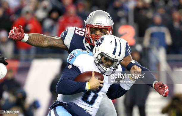 Marquis Flowers of the New England Patriots tackles Marcus Mariota of the Tennessee Titans in the third quarter of the AFC Divisional Playoff game at...