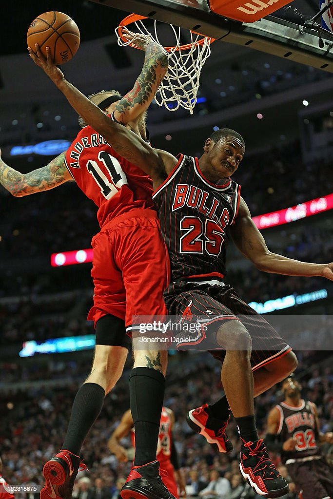 Marquis Teague #25 of the Chicago Bulls collides with Chris Anderson #11 of the Miami Heat while trying to shoot at the United Center on February 21, 2013 in Chicago, Illinois. The Heat defeated the Bulls 86-67.