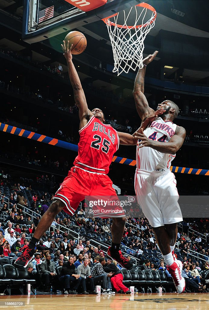 Marquis Teague #25 of the Chicago Bulls drives to the basket against Ivan Johnson #44 of the Atlanta Hawks on December 22, 2012 at Philips Arena in Atlanta, Georgia.