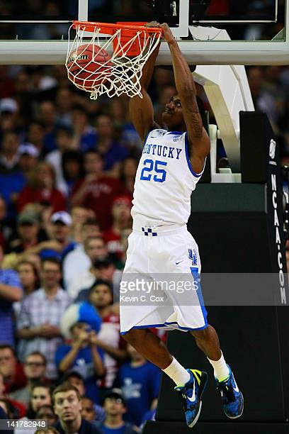 Marquis Teague of the Kentucky Wildcats dunks on the Indiana Hoosiers in the first half during the 2012 NCAA Men's Basketball South Regional...