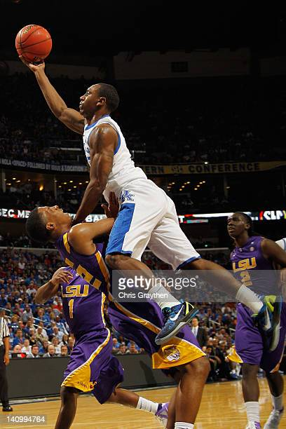 Marquis Teague of the Kentucky Wildcats shoots the ball over Ralston Turner of the LSU Tigers during the quarterfinals of the SEC Men's Basketball...