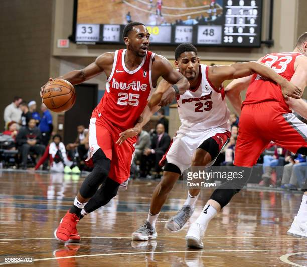Marquis Teague of the Memphis Hustle drives to the basket past Rodney Pryor of the Sioux Falls Skyforce during an NBA GLeague game on December 25...