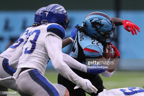 Marquis Young of the Dallas Renegades tries to evade tackle by Kenny Robinson of the St Louis Battlehawks on February 09 2020 in Arlington Texas