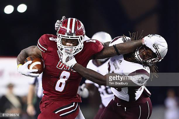 Marquis Young of the Massachusetts Minutemen stiff arms Lashard Durr of the Mississippi State Bulldogs during the second half of their game at...