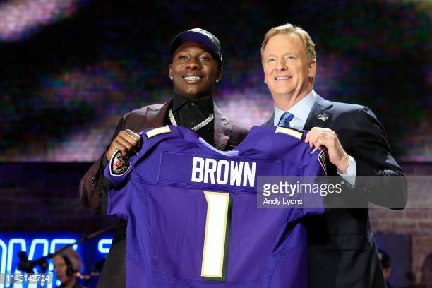 Marquise Brown of Oklahoma poses with NFL Commissioner Roger Goodell after being chosen overall by the Baltimore Ravens during the first round of the...