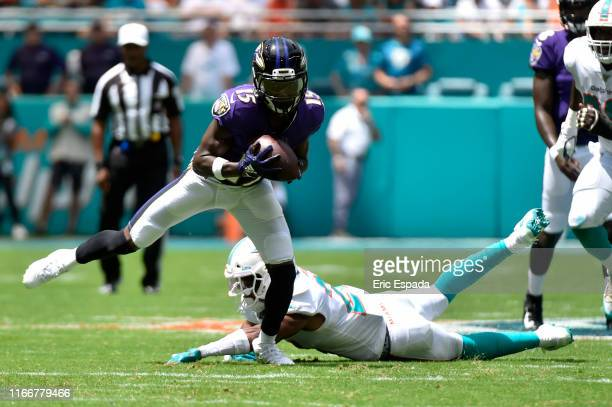Marquise Brown of the Baltimore Ravens catches a 47 yard touchdown pass from Lamar Jackson in the first quarter against the Miami Dolphins at Hard...