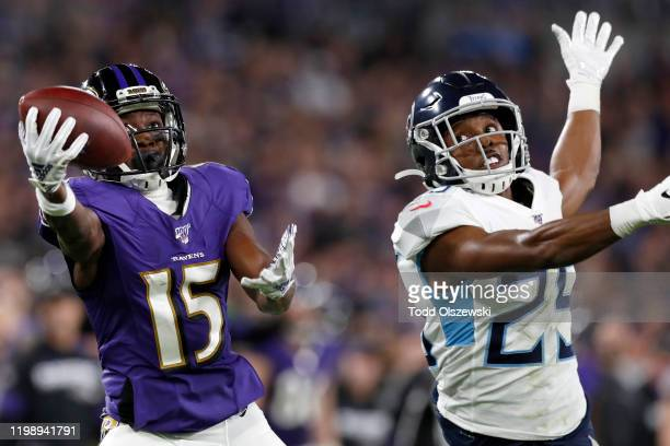 Marquise Brown of the Baltimore Ravens catches a deep pass over Adoree' Jackson of the Tennessee Titans in the second quarter of the AFC Divisional...