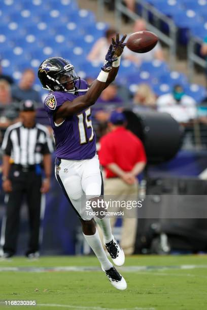 Marquise Brown of the Baltimore Ravens catches a pass during warms ups prior to a preseason game against the Jacksonville Jaguars at MT Bank Stadium...