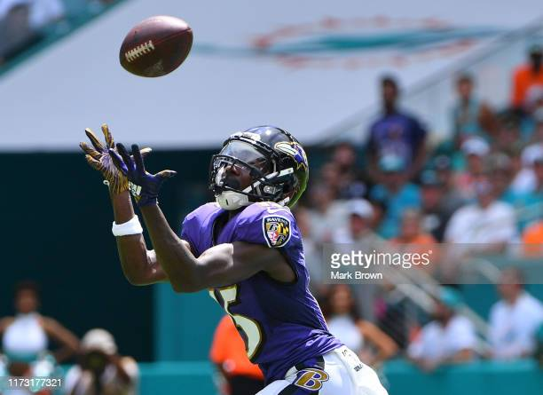 Marquise Brown of the Baltimore Ravens catches a pass for a touchdown in the first quarter against the Miami Dolphins at Hard Rock Stadium on...