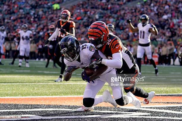 Marquise Brown of the Baltimore Ravens catches a touchdown during the NFL football game against the Cincinnati Bengals at Paul Brown Stadium on...