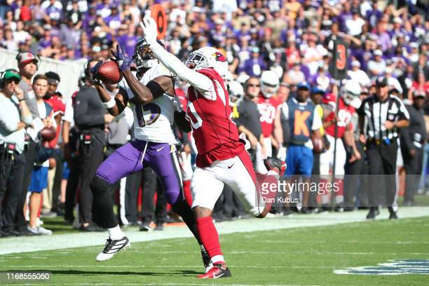 Marquise Brown of the Baltimore Ravens makes a catch over Tramaine Brock of the Arizona Cardinals during the second half at MT Bank Stadium on...