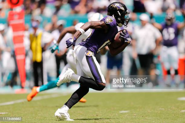 Marquise Brown of the Baltimore Ravens runs to the end zone to score a touchdown on a 47yard pass from Lamar Jackson during the first quarter against...