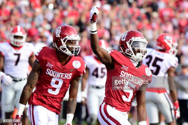 Marquise Brown of the Oklahoma Sooners and CeeDee Lamb of the Oklahoma Sooners react in the 2018 College Football Playoff Semifinal at the Rose Bowl...