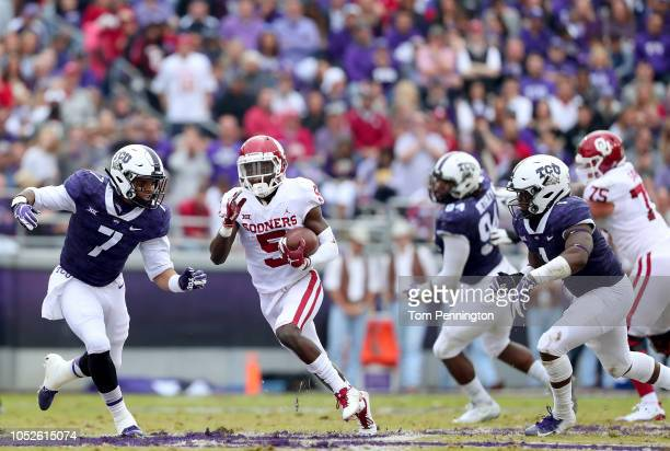 Marquise Brown of the Oklahoma Sooners carries the ball against Arico Evans of the TCU Horned Frogs in the first half at Amon G Carter Stadium on...