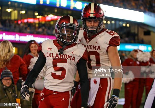 Marquise Brown of the Oklahoma Sooners celebrates after catching a 45 yard touchdown pass against the West Virginia Mountaineers on November 23 2018...