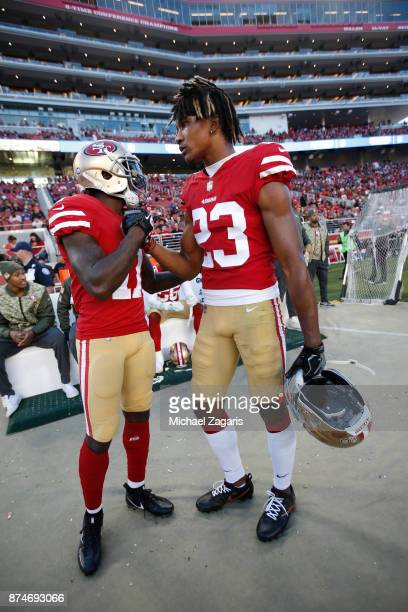 Marquise Goodwin and Ahkello Witherspoon of the San Francisco 49ers talk on the sideline during the game against the New York Giants at Levi's...