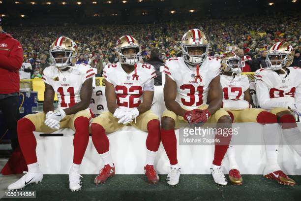 Marquise Goodwin Matt Breida Raheem Mostert Victor Bolden Jr #17 and Kendrick Bourne of the San Francisco 49ers sit on the sideline prior to the game...
