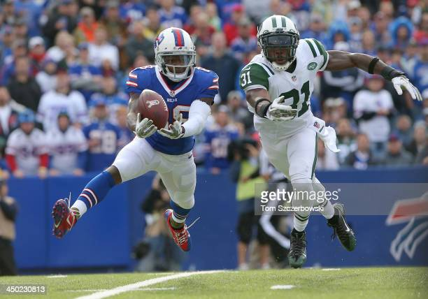 Marquise Goodwin of the Buffalo Bills cannot catch a pass during NFL game action as Antonio Cromartie of the New York Jets defends at Ralph Wilson...