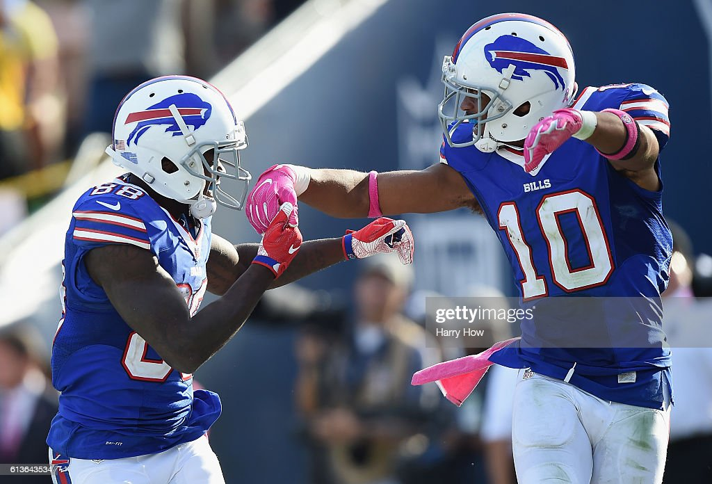 Marquise Goodwin #88 of the Buffalo Bills celebrates his touchdown with teammate Robert Woods #10 to take a 30-19 lead in the fourth quarter of the game against the Los Angeles Rams at the Los Angeles Memorial Coliseum on October 9, 2016 in Los Angeles, California.
