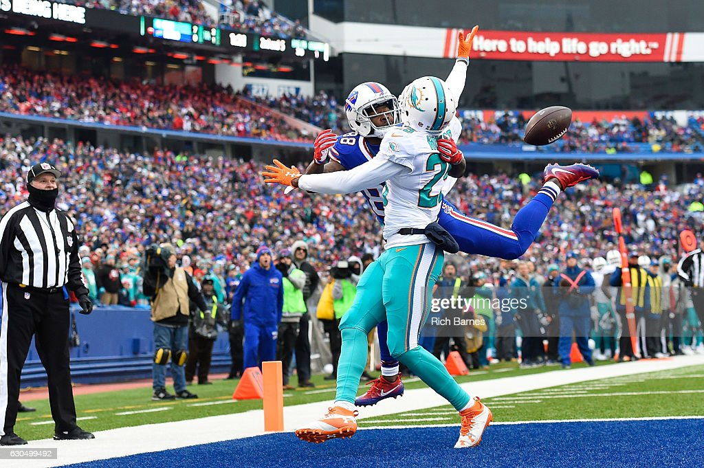 Marquise Goodwin #88 of the Buffalo Bills has his pass broken up by Xavien Howard #25 of the Miami Dolphins during the first half at New Era Stadium on December 24, 2016 in Orchard Park, New York.