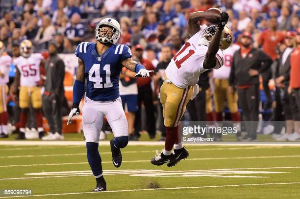 Marquise Goodwin of the San Francisco 49ers catches a pass in front of Matthias Farley of the Indianapolis Colts during the fourth quarter of a game...
