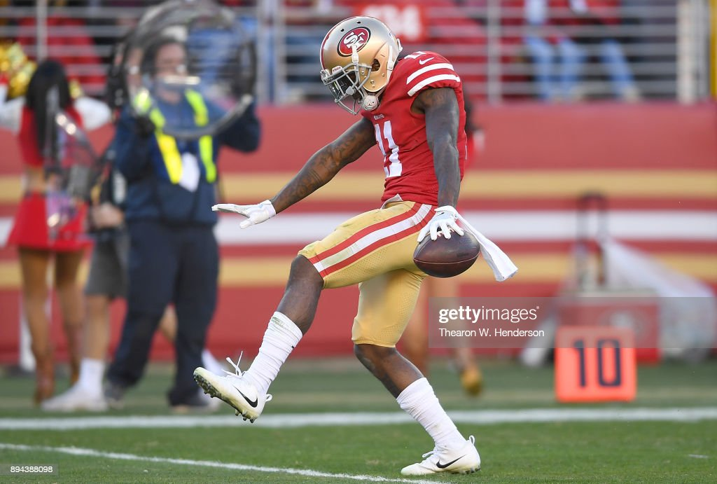 Marquise Goodwin #11 of the San Francisco 49ers celebrates after catching a pass for a first down against the Tennessee Titans during their NFL football game at Levi's Stadium on December 17, 2017 in Santa Clara, California.