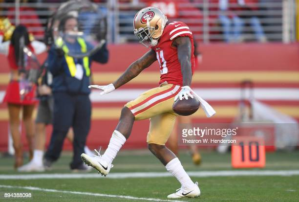 Marquise Goodwin of the San Francisco 49ers celebrates after catching a pass for a first down against the Tennessee Titans during their NFL football...