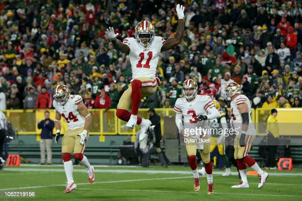 Marquise Goodwin of the San Francisco 49ers celebrates after scoring a touchdown in the second quarter against the Green Bay Packers at Lambeau Field...