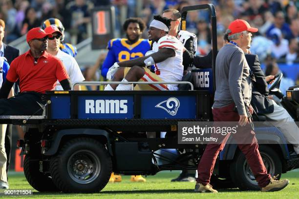 Marquise Goodwin of the San Francisco 49ers is carted off the field after after being injured on a play involving Blake Countess of the Los Angeles...