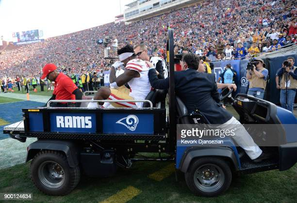 Marquise Goodwin of the San Francisco 49ers is carted off the field after being injured on a play involving Blake Countess of the Los Angeles Rams...