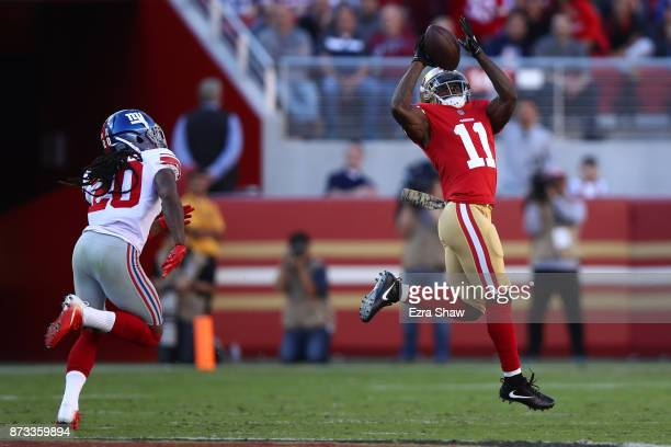 Marquise Goodwin of the San Francisco 49ers makes a catch on his way to against the New York Giants83yard touchdown against the New York Giants...