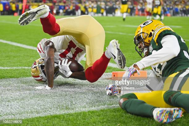 Marquise Goodwin of the San Francisco 49ers scores a touchdown in front of Tramon Williams of the Green Bay Packers during the second quarter at...
