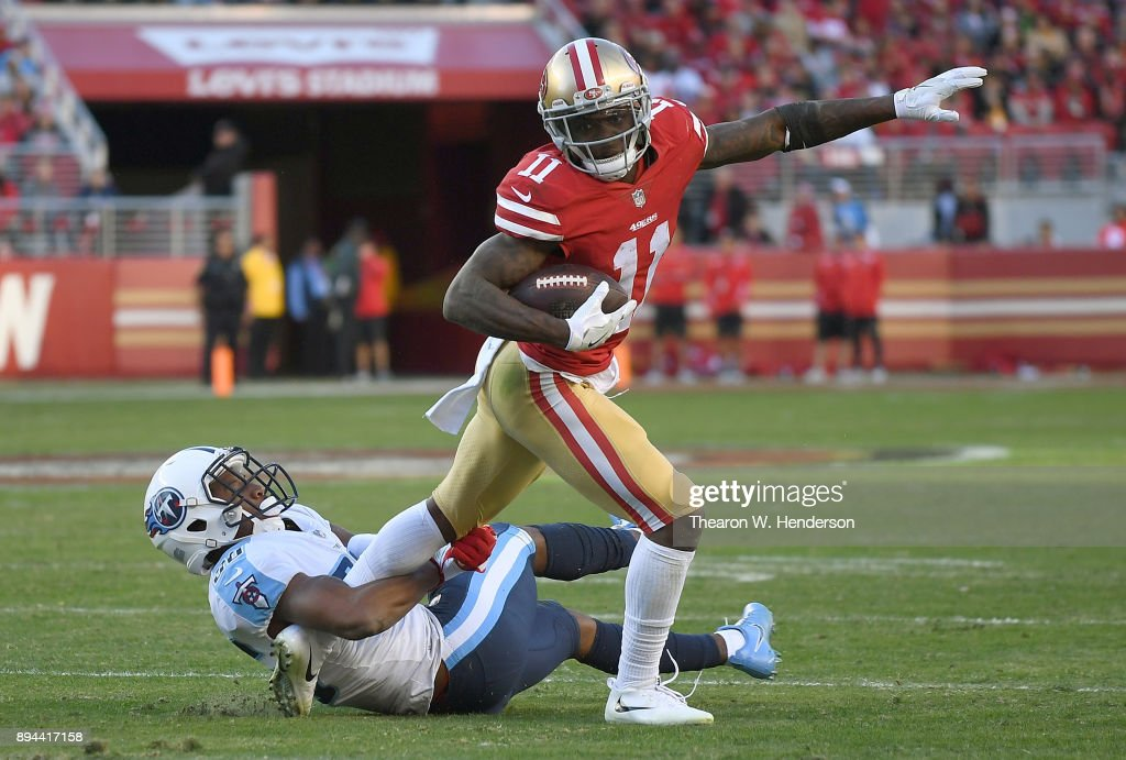 Marquise Goodwin #11 of the San Francisco 49ers tries to fight off the tackle of LeShaun Sims #36 of the Tennessee Titans late in the fourth quarter of their NFL football game at Levi's Stadium on December 17, 2017 in Santa Clara, California.