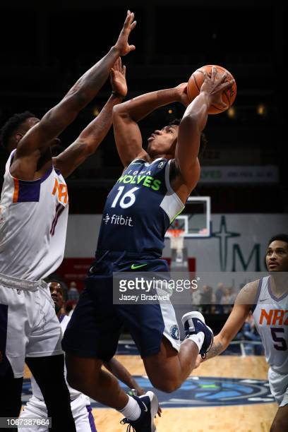 Marquise Moore of the Iowa Wolves goes up for a shot against Derek Cooke Jr #11 of the Northern Arizona Suns in an NBA GLeague game on December 1...