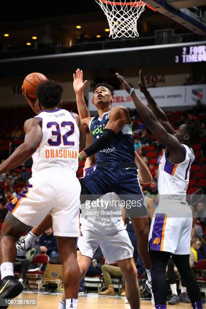 Marquise Moore of the Iowa Wolves goes up for a shot against Retin Obasohan of the Northern Arizona Suns in an NBA GLeague game on December 1 2018 at...