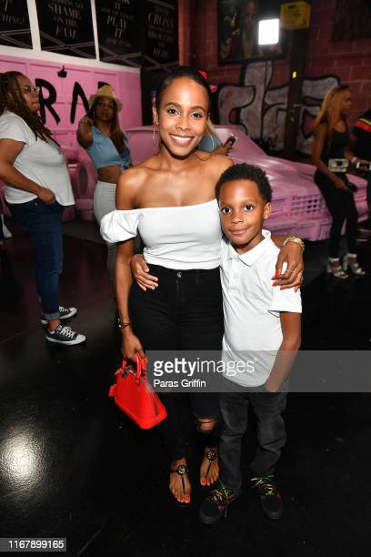 Marquita Goings and Michael Jennings attend the Nipsey Hussle Exhibit Unveiling at The Trap Music Museum on August 13 2019 in Atlanta Georgia