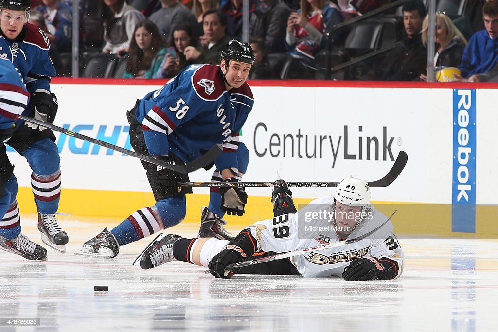 Marr Beleskey #39 of the Anaheim Ducks falls to the ice as he is pursued by Patrick Bordeleau #58 of the Colorado Avalanche at the Pepsi Center on March 14, 2014 in Denver, Colorado.