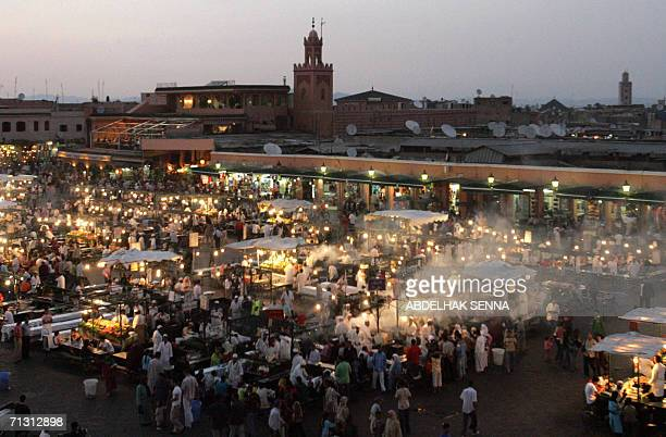 A general view taken late 27 June 2006 shows the Jemaa el fna square in Marrakech which attracts many tourists as well as poor children who sell...