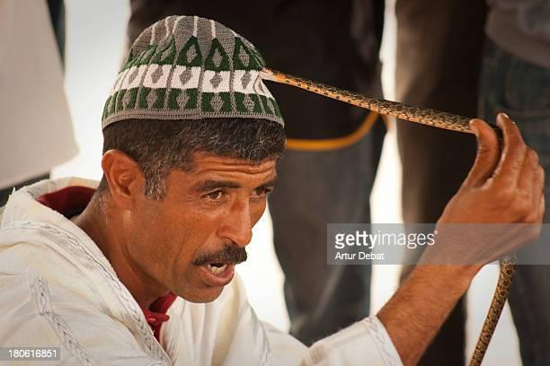 "Marrakech Morocco africa hat snake bites bite small ""jemaa el Fna"" show performance travel trip"