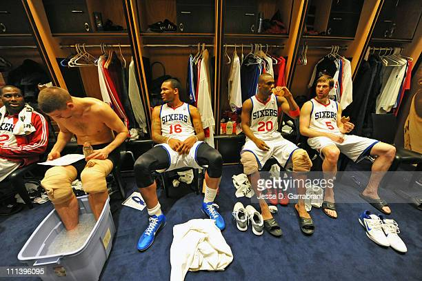 Marreese Speights Jodie Meeks and Andres Nocioni of the Philadelphia 76ers sit in the lockerroom after the game against the New Jersey Nets on April...