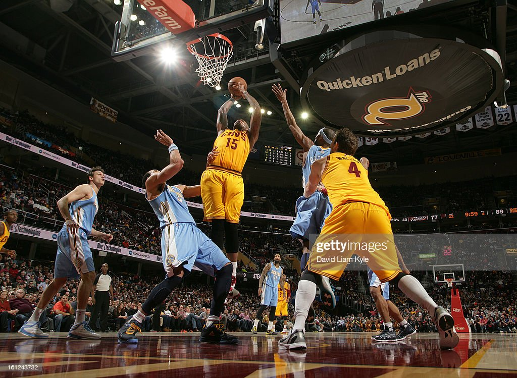 Marreese Speights #15 of the Cleveland Cavaliers goes up for the shot against JaVale McGee #34 and Corey Brewer #13 of the Denver Nuggets at The Quicken Loans Arena on February 9, 2013 in Cleveland, Ohio.