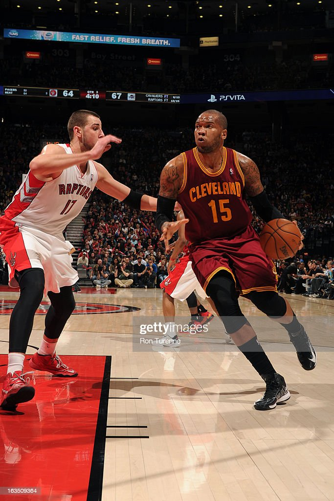 Marreese Speights #15 of the Cleveland Cavaliers handles the ball against Jonas Valanciunas #17 of the Toronto Raptors on March 10, 2013 at the Air Canada Centre in Toronto, Ontario, Canada.