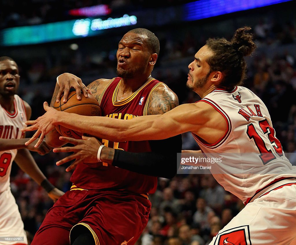 Marreese Speights #15 of the Cleveland Cavaliers is fouled by Joakim Noah #13 of the Chicago Bulls at the United Center on February 26, 2013 in Chicago, Illinois.