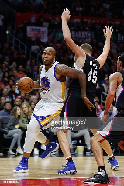 Marreese Speights of the Golden State Warriors dribbles past Cole Aldrich of the Los Angeles Clippers during the second half of a game at Staples...
