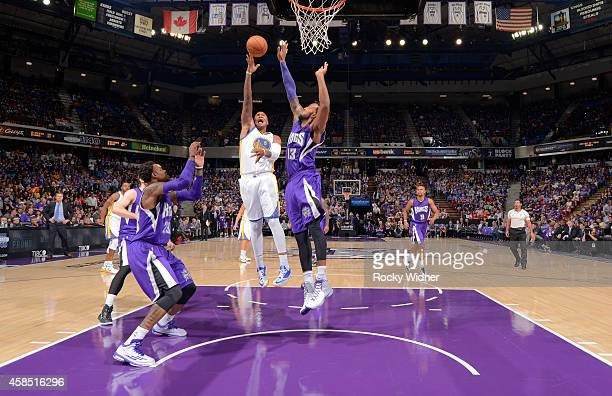 Marreese Speights of the Golden State Warriors shoots against Derrick Williams of the Sacramento Kings on October 29 2014 at Sleep Train Arena in...