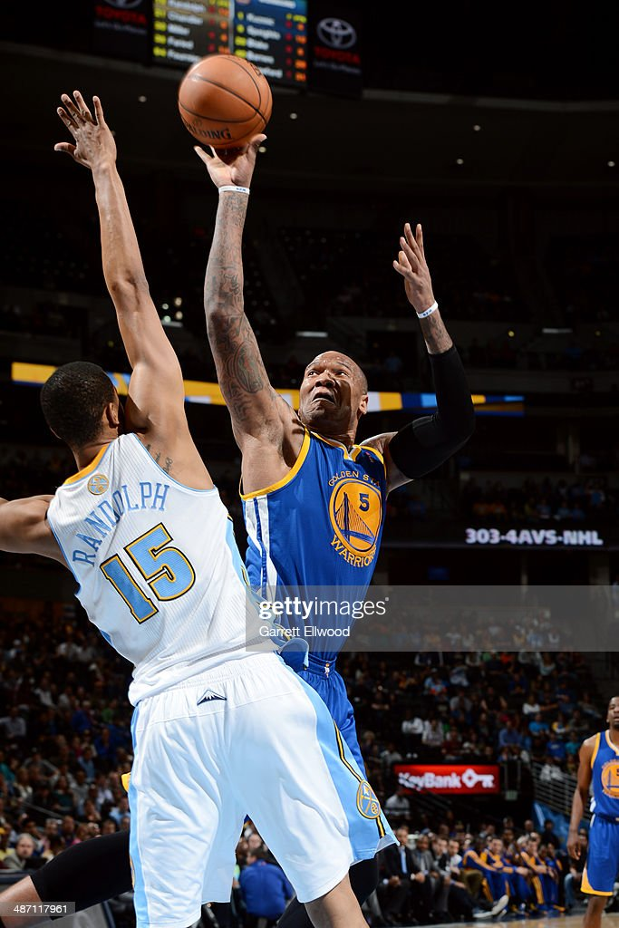 Marreese Speights #5 of the Golden State Warriors shoots against the Denver Nuggets on April 16, 2014 at the Pepsi Center in Denver, Colorado.