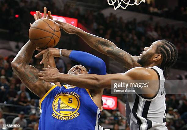 Marreese Speights of the Golden States Warriors has his shot blocked by Kawhi Leonard of the San Antonio Spurs at ATT Center on March 19 2016 in San...
